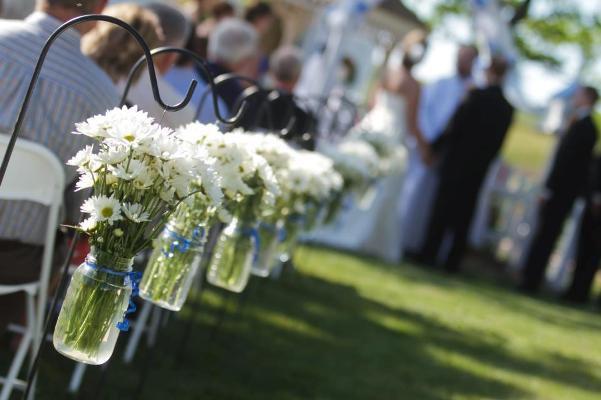 From Billie Wilson- Mason jars as darling aisle vases