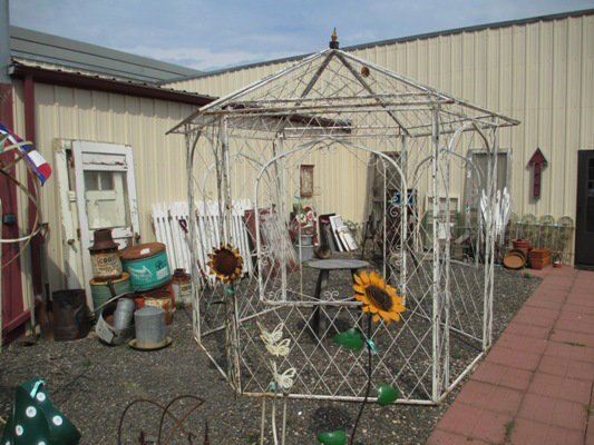 A stately old ironwork gazebo....to die for