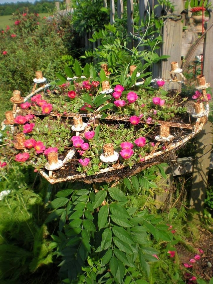 An awesome antique candelabra frames some rose moss.