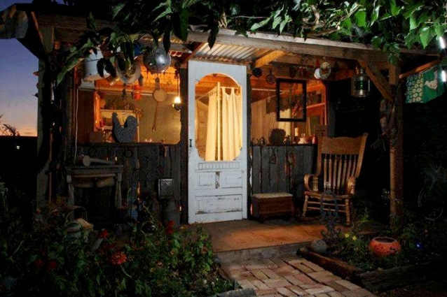 """Lisa Royal says, """"My husband built this shanty for me in my garden. It is filled with Flea Market finds and treasures i have collected over the years. Family and friends love to visit and spend the night in this little treasure."""""""