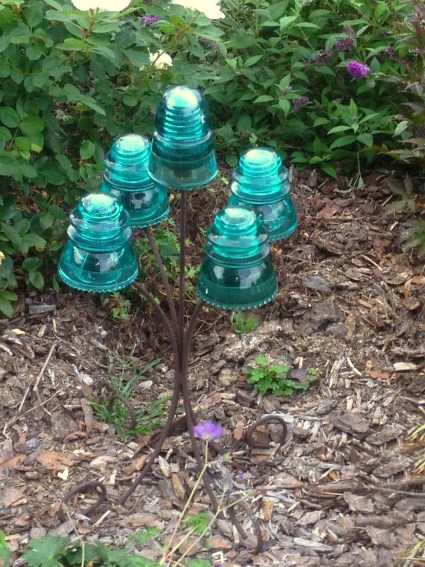 "Rhea Dawn says, ""I took a candle stand and made a display for a few of my insulators that I collect."""