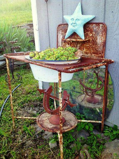 Kathy Engel's sink has that rusty 'patina' we Flea market gardeners love.