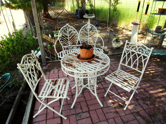 Metal cafe chairs last and last in Lisa Rice's cool and breezy shade garden