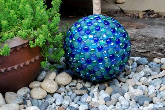 Dot Baker's glowing blue and teal ball was painted first, then decorated with craft store gems