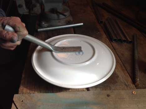 Linda Gerstner shows how copper conduit or aluminum pipe can be hammered flat and glued to a dish or plate and used as a 'stem.'
