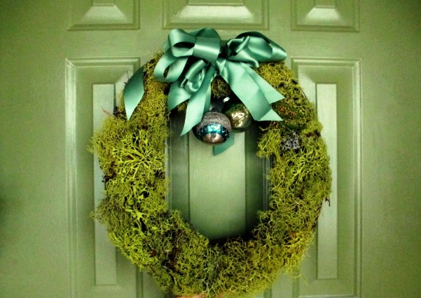Complete with a blue-green bow and vintage ornaments