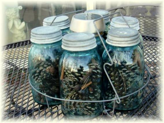Old canning jars filled now with pinecones and things