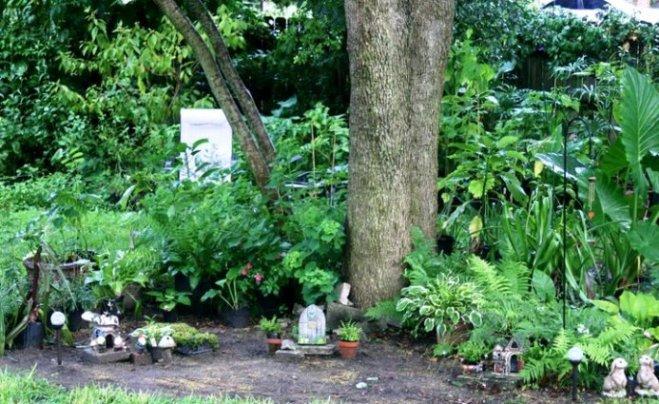 Mary Ann Matzer clears a spot for a fairy village
