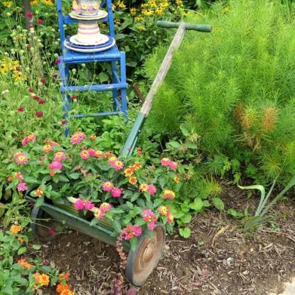 Around every corner one came upon a new and inventive flower display, like this old fashioned push mower filled with lantana..