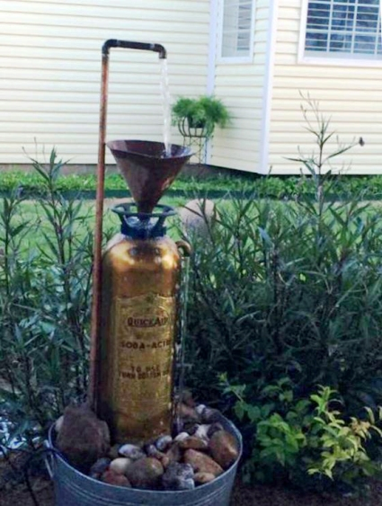 Mexican petunias grow behind Melody Sisk's 'fireman's' fountain