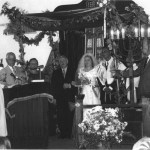 Rabbi Cywiak performing a wedding ceremony for his granddaughter, Sara.