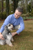 Tim Link With One of His Schnauzers, Buzz