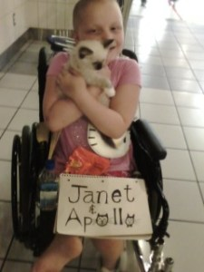 Kyra holding Apollo in St. Louis Airport