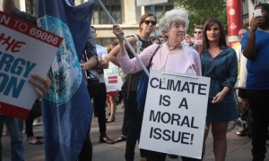 Environmental activists protest Donald Trump's decision to exit the Paris climate accords, which set a goal of avoiding warming beyond 2C. Photograph: Scott Olson/Getty Images