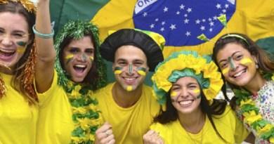Group of happy brazilian soccer fans.