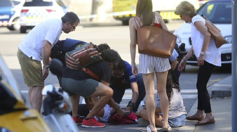 x71110864_A-person-is-treated-in-Barcelona-Spain-Thursday-Aug-17-2017-after-a-white-van-jumped-the-si.jpg.pagespeed.ic.EMU3CLpuFb