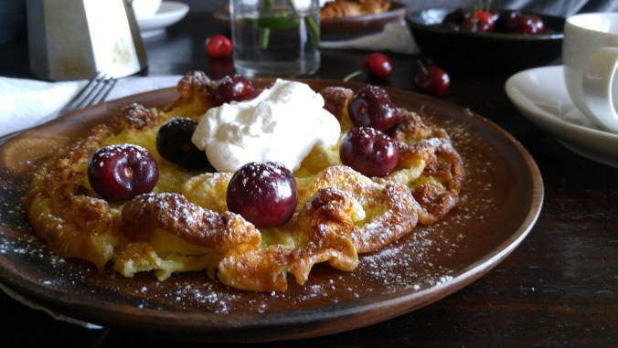 Dutch baby pancakes with cherry compote.