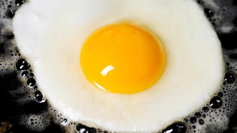 "Learn how to fry an egg with our super-easy step-by-step guide. You'll never ""accidentally"" scramble one again."