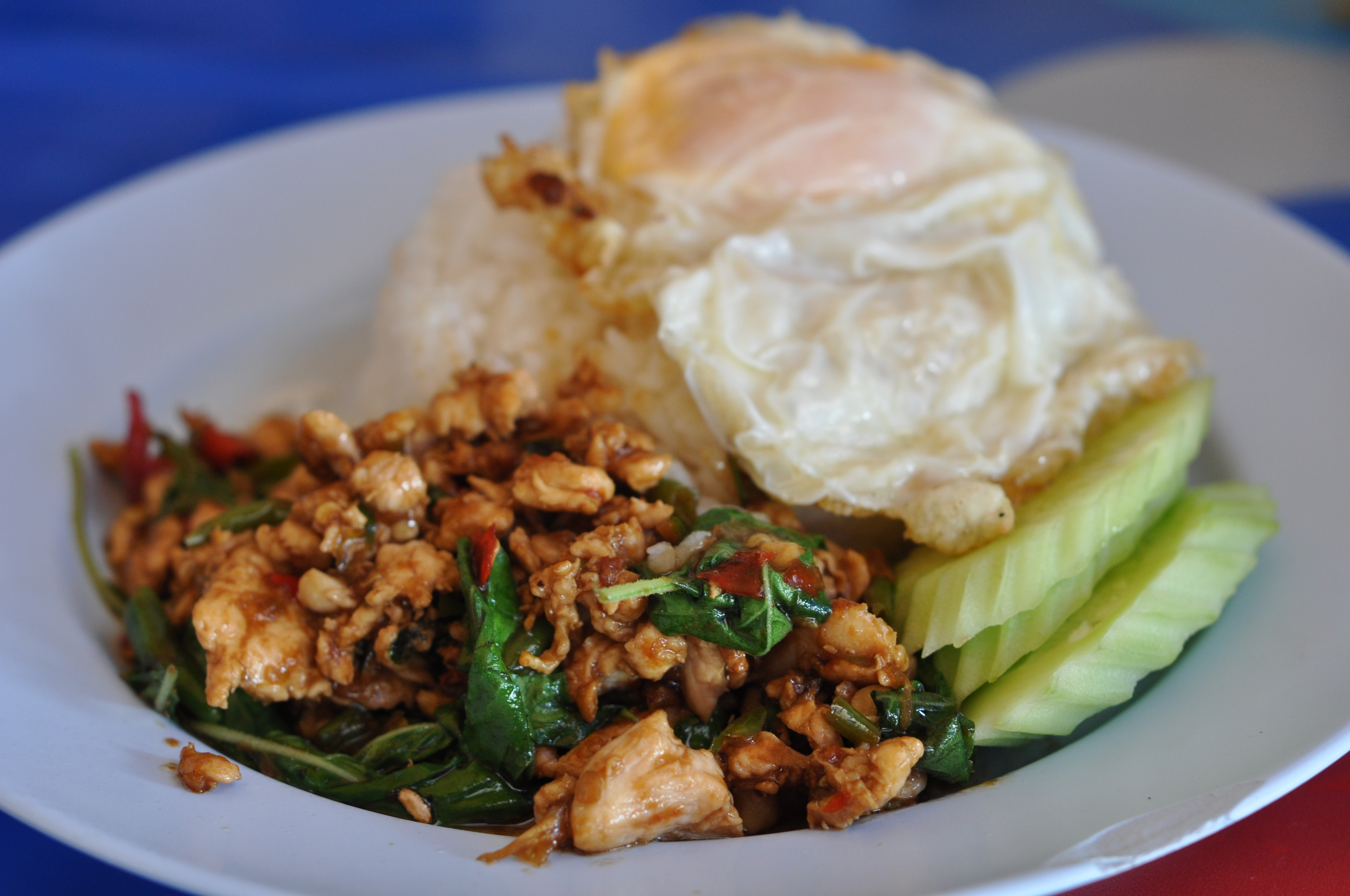 authentic thai dishes and how to spot their fake versions food look for a street vendor that serves traditional pad kra prao a crispy fried egg