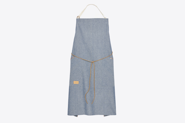 "To celebrate his newest cookbook, ""Besh Big Easy,"" chef John Besh collaborated with designer Billy Reid on this apron. (Photo courtesy of Billy Reid.)"