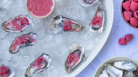 These oysters with a raspberry mignonette are sure to please any crowd.