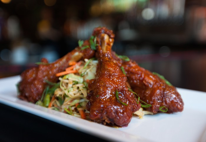These crispy duck wings are glazed with a hoisin-based sauce that's tangy, sweet, and savory. (Photo credit: Tom's Urban)