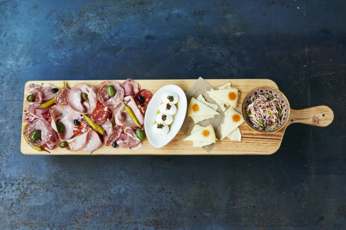 These oversized wooden planks loaded with bufala mozzarella and fennel salami is an engaging visual.