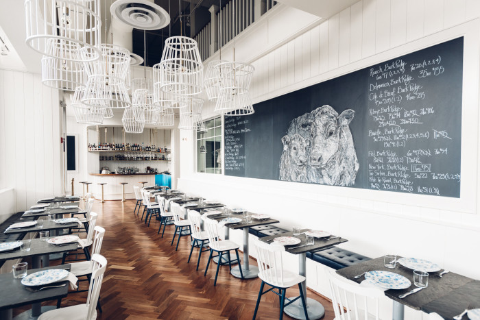 This pretty, contemporary steakhouse by restaurant by Renee Erickson specializes in unusual cuts of beef. (Photo credit: David Dosset)