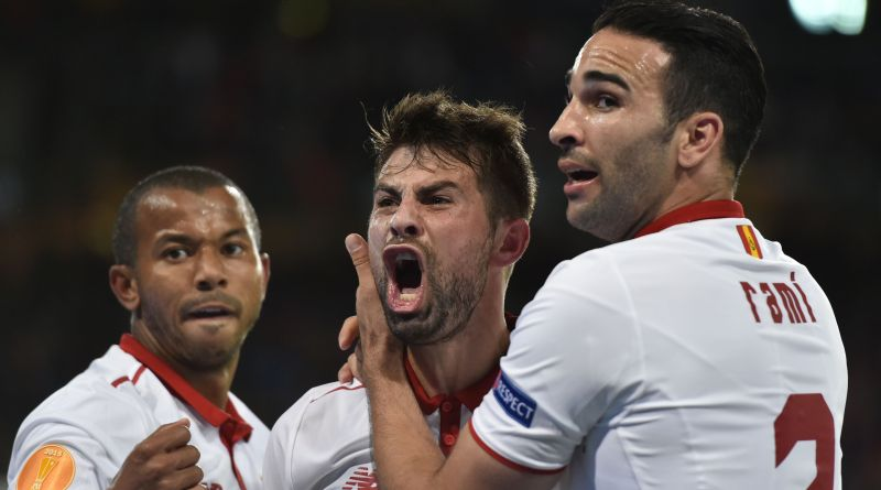 Sevilla's Spanish defender and captain Coke  (L) celebrates with teammates after scoring a goal during the UEFA Europa League final football match between Liverpool FC and Sevilla FC at the St Jakob-Park stadium in Basel, on May 18, 2016.   AFP PHOTO / MICHAEL BUHOLZER
