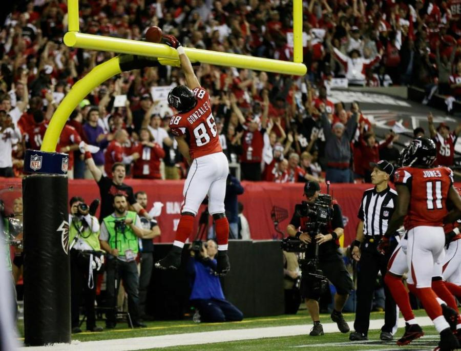 Tony watches Tony. Falcons tight end Tony Gonzelez celebrates a touchdown while back judge Tony Steratore makes sure there is not an excessive celebration foul. (Jimmy Cribb/Atlanta Falcons)