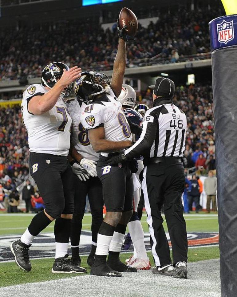 Back judge Perry Paganelli sends players back to the sideline as Ravens receiver Anquan Boldin celebrates a touchdown. (Baltimore Ravens photo)
