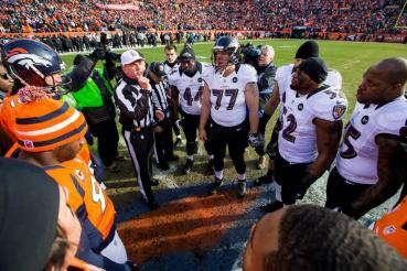 Bill Vinovich conducts the coin toss at the beginning of the game (Baltimore Ravens photo)