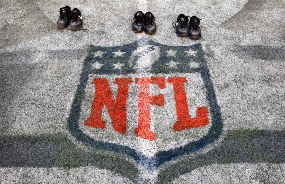 The shoes worn by referee Scott Green, umpire Scott Dawson and side judge Larry Rose at midfield of the Pro Bowl after they completed their final game of their careers [Michael Yanow/NFL].