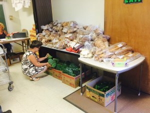 Volunteer Galina with Bread and Vegetable Donations