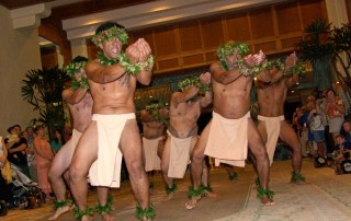 Members of Na Kane O Keoneloa Pa Hula perform an ancient hula in the style of ki`i. Photo by Anne E. O'Malley