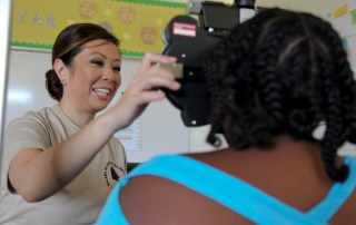 Optometrist Maj. Tina Burr was deployed in Tropic Care Kaua'i 2014, and assisted with free eye exams. This year from June 20 to 29, Tropic Care Kaua'i 2016 will provide dental, medical, and optometric services including sports physicals, optometry exams, eyeglass production, adult health exams, tooth extractions, dental exams, and minor fillings.  U.S. Army Photo by Pfc. Kevin Kim/Released