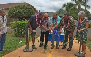 Officials gathered last week for the blessing of an enhanced crosswalk and shared use path in Līhu'e. From L to R: Donald Fujimoto, project manager, Department of Public Works; Brian Alston, Resident Services Manager, Lihue Court Townhomes; Roland Ruiz, Property Manager, Līhu'e Court Townhomes; Jeff Fisher, president, Earthworks Pacific; Mayor Bernard Carvalho, Jr.; and former Mayor Maryanne Kusaka.