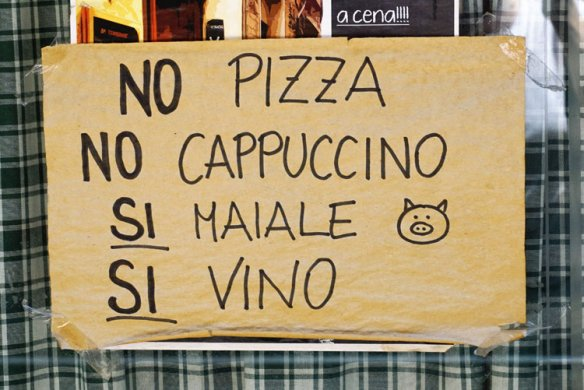 The sign in the window at Trombiche; a little dig at all the tourists. No, we don't have pizza or cappucchino, but we do have pork and wine! A place after my own heart.