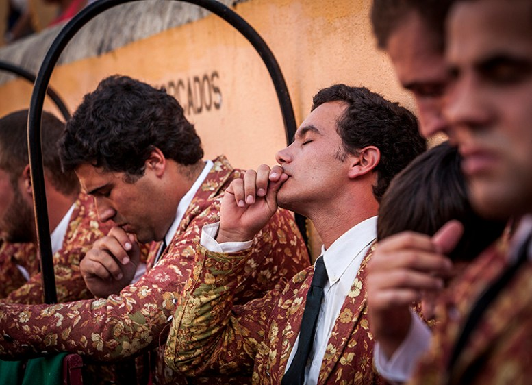 Blessings before wrestling the bull: Before each time a the group enters in the arena to face the bull forcados performe a small blessing. Forcados groups are extremely religious. Reguengos de Monsaraz, Portugal.