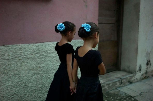 Two girls going home after their dance class. Dance is extremely popular in Cuba. Boys play baseball and girls dance. Habana Viera, calle Gloria, November, 2013.