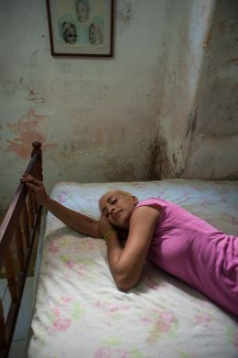 a young woman rests in her moldy bedroom