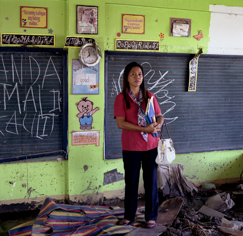 Imelda M. Gayas is the school principal of San Fernando Central School, one of the badly damaged school in Tacloban as it is located only 100 meters from the shore. As fourteen of its classrooms collapsed, around 1,200 students were displaced. The school is currently operating in temporary tents donated by Unicef and the American Red Cross. January 6, 2014. Tacloban