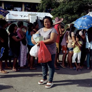Rosela Diaz (37), from Barangay 35-A, Tacloban among other survivors rely on relief goods from DSWD. January 5, 2014.