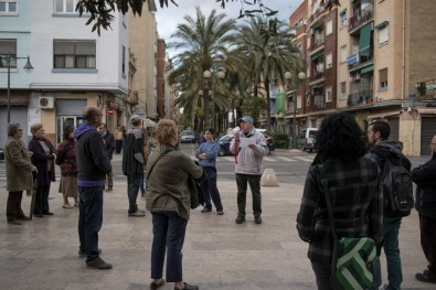 The President of the neighbourhood association speaks at a protest in front of locals in the impoverished neighbourhood of Nazaret, Valencia. The community in Nazaret has been protesting for years for the roads to be widened so that medical services can enter the neighborhood, but due to government cuts there are many areas like Nazaret across Spain that are feeling the full effect of the crisis.