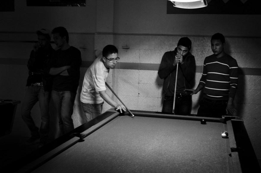 Teenagers plays snooker at the café in Kairouan