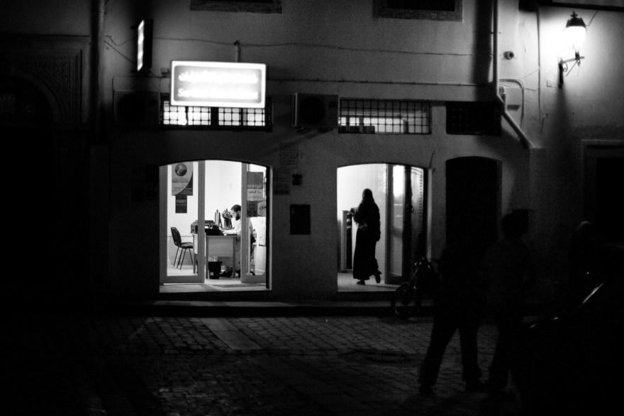 Women walks out of the house, Kairouan