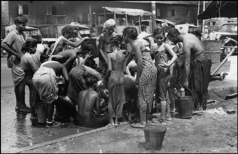 BURMA. Yangon (Rangoon). 1948. The rebels cut the city's water supply and the inhabitants hurried to collect whatever might be left in the pipes.