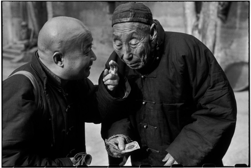 CHINA. Beijing. December 1948. This impervious old man at the right is a eunuch who once served in the court of the Dowager Empress Tzu Hsi when the Imperial Court counted 400 eunuchs. They served as chamberlains to the emperors and their concubines. By 1949, only 40 eunuchs still survived and they were living in a monastery.