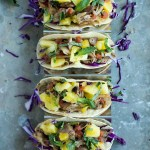 These Slow Cooker Pork Tacos let your slow cooker do most of the work. Crunchy purple cabbage, tender pork and a juicy pineapple mint salsa create a taco bursting with flavor!