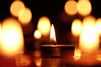Candles light, black background.